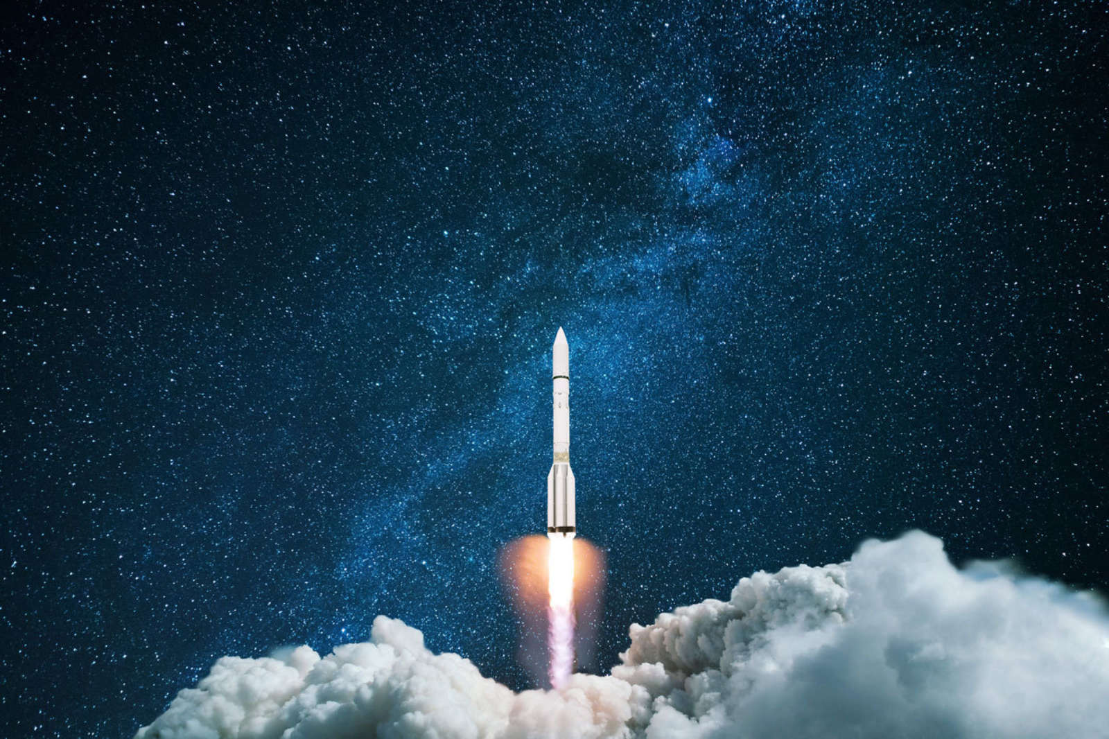 A rocketship launches into a star studded nightsky